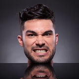 Head of angry young man Royalty Free Stock Photos
