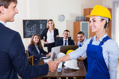 The head of architecture bureau and main specialist handshaking Royalty Free Stock Photo