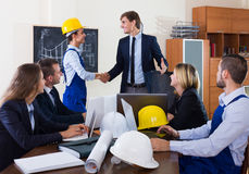 The head of architecture bureau and main specialist handshaking Stock Photography
