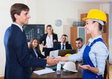 The head of architecture bureau and main specialist handshaking Stock Images