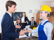 The head of architecture bureau and main specialist handshaking Stock Photos