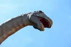Head of an artificial Diplodocus dinosaur against the sky Stock Images