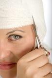 Head bandage cutting Stock Photography