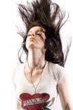 Head banger. Woman headbangs to music in headphones with hair flying everywhere Royalty Free Stock Photos