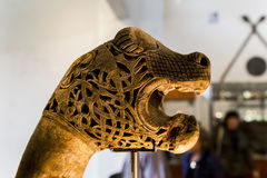 The head of the beast. OSLO, NORWAY - JULY 1, 2016: It is ancient carved decoration in the form of the head of the beast from Viking Ship Museum stock images