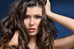 Head of the beautiful woman with long hair. Royalty Free Stock Photos