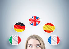 Head of blond woman and five flags Royalty Free Stock Image