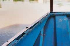 Head of boat floats near the shore. Blue river beautiful Royalty Free Stock Image