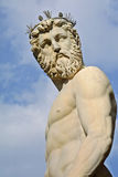 The head and body of Neptune against a blue sky Royalty Free Stock Photo