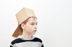 Head in the box. Сardboard box on the head, young boy Stock Images