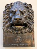 Bronze Lion head on the wall royalty free stock photography