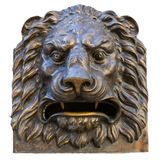 Bronze head of Lion. The head of bronze lion stated on the wall. Outdoors, close up, isolate stock image