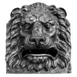 Bronze head of Lion. The head of bronze lion stated on the wall. Outdoors, close up, isolate, black and white stock image