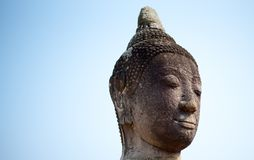 Head of buddha in bluesly royalty free stock images