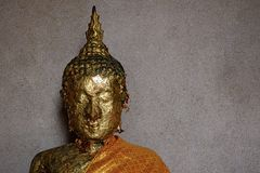 Head of Buddha image with gold leaf on face. Stock Photo