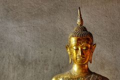Head of Buddha image with gold leaf on face. Royalty Free Stock Photography