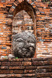 Head of buddha. The old head of Buddha in temple Stock Photography