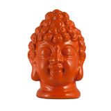 Head of Buddha. Orange clay head of Buddha isolated on white stock image