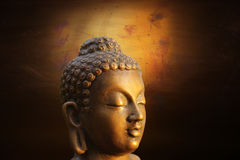 Head of Budha on golden background Royalty Free Stock Images