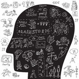Head of business icons and doodles Stock Images