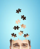 Head businessman built of puzzle Royalty Free Stock Images