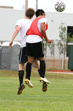 Head. Two soccer players jumping to head the ball stock images