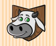 Head of a cartoon cow mounted on a wall royalty free stock image