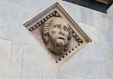 Head Carved in Marble on the Facade of the Baptistery of Siena Cathedral Royalty Free Stock Image