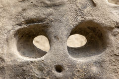 Head carved in rock Stock Image
