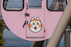 The head of a cat decorates the car of a Ferris wheel (Japan) Royalty Free Stock Photo