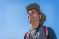 Caucasian male tourist with a hat portrait. Head of a Caucasian male tourist wearing a hat and looking ahead in summer royalty free stock images