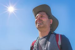 Caucasian male tourist with a hat portrait. Head of a Caucasian male tourist wearing a hat and looking ahead in summer stock image