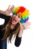 Head of the cheerful girl multi-colored wig Royalty Free Stock Photos