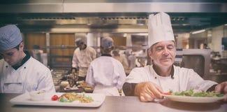 Head chef checking salad Stock Photos