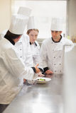 Head chef explaining something to class Royalty Free Stock Photo
