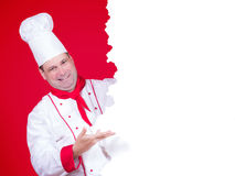 Head chef offers a menu. Head chef offers a empty menu on red background royalty free stock image