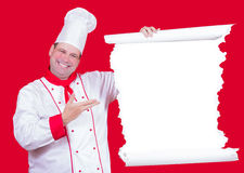 Head chef offers a menu Royalty Free Stock Photos