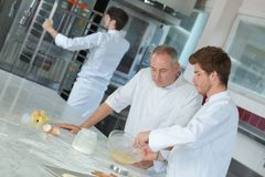 Head-chef rating plate one apprentices in kitchen stock photo