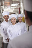Head Chef Speaking to Assistants Royalty Free Stock Images