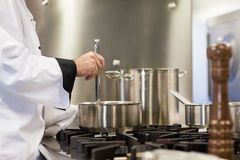 Head chef stirring in pot Royalty Free Stock Image