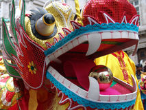 Head of Chinese Dragon. Close up of Chinese dragon dancing in Chinatown, London, England stock photos