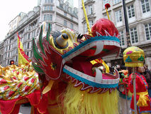 Head of Chinese Dragon dancing. Close up of Chinese dragon dancing in Chinatown, London, England stock photography
