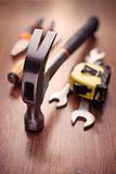 Head of a Claw Hammer on a Table with Other Tools Royalty Free Stock Image