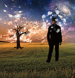 Head in clouds. Dreamlike Surreal Scene in Landscape Stock Image