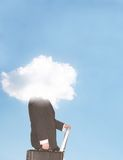Head in clouds. Businessman stands on a ladder holding his briefcase with his head in the clouds Royalty Free Stock Image