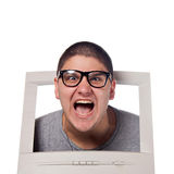 Head Coming Out of a Computer. A young man popping his head out of a computer monitor with nerd glasses stock images