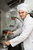 Head-cooks cooking at professional kitchen Stock Images