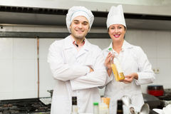 Head-cooks cooking at professional kitchen Stock Image