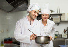 Head-cooks cooking at professional kitchen Royalty Free Stock Images