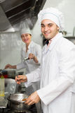 Head-cooks cooking at professional kitchen Stock Photos